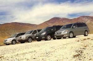 Group of 2005 minivans in desert