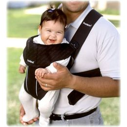 A man with a baby in a baby carrier