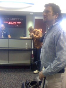 A man eating bbq at the airport