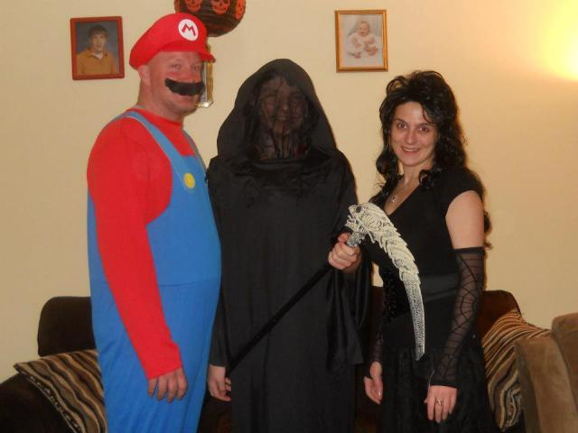 2012: The first year we did our own thing lol. Mario, the grim reaper (inspired by the premiere of Lil' Horsemen) and Bellatrix Lestrange from Harry Potter. Mario got all the attention that night, and somehow my son and I still managed to go dark lol.